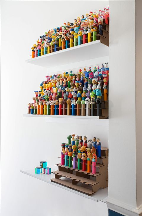 Shelf, Shelving, Furniture, Room, Collection, Toy, Interior design, Art,