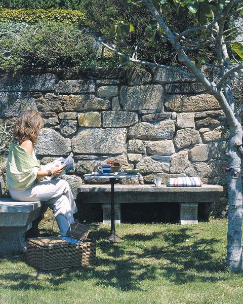 Sitting, Outdoor furniture, Stone wall, Lap, Guitar, Outdoor bench, Bench, Outdoor table, Park, Picnic,