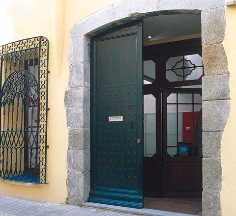 Blue, Architecture, Wall, Door, Home door, Fixture, Iron, Door handle, Arch, Metal,