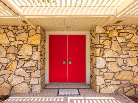 Yellow, Property, Door, Wall, Floor, Real estate, Ceiling, Home door, Fixture, Stone wall,