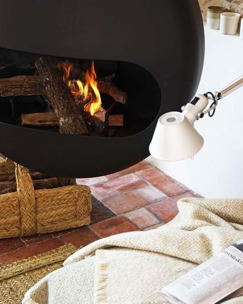 Flame, Fire, Heat, Gas, Beige, Home accessories, Hearth, Fireplace, Linens, Building material,