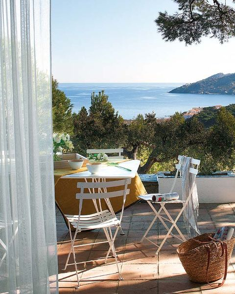 Table, Furniture, Chair, Glass, Outdoor furniture, Curtain, Ocean, Outdoor table, Window treatment, Restaurant,