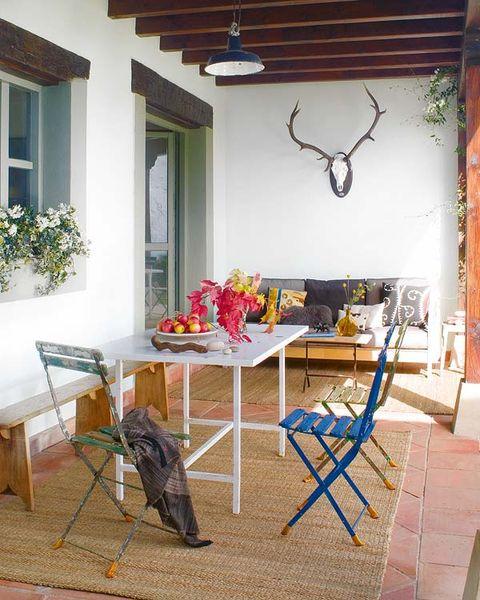 Window, Room, Table, Furniture, Interior design, Antler, Ceiling, Light fixture, Chair, Fixture,