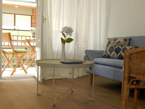 Furniture, Room, Floor, Living room, Interior design, Table, Curtain, Property, Coffee table, Chair,