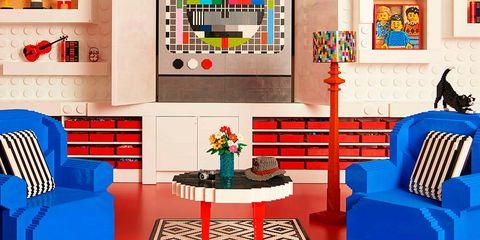 Living room, Room, Furniture, Interior design, Blue, Yellow, Orange, Wall, Shelf, Couch,