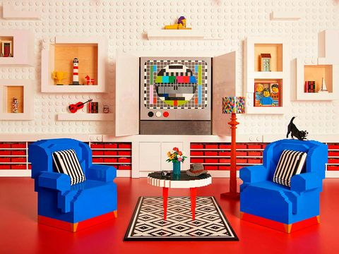 Living room, Room, Interior design, Furniture, Blue, Wall, Orange, Couch, Table, Shelf,