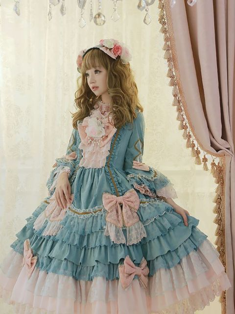 Clothing, Ruffle, Dress, Victorian fashion, Waist, Pink, Fashion, Costume design, Sleeve, Embellishment,