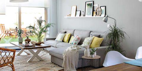 Living room, Room, Furniture, Interior design, Table, Coffee table, Lighting, Floor, Home, Yellow,