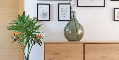 Furniture, Vase, Table, Room, Floor, Interior design, Wood, Flooring, Plant, Shelf,