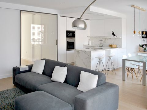 Living room, Furniture, Room, Interior design, White, Property, Floor, Couch, Table, Coffee table,