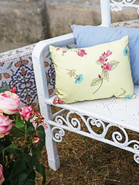 Textile, Petal, Pink, Cushion, Linens, Throw pillow, Bag, Home accessories, Flowering plant, Shrub,