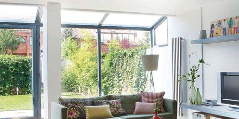 Room, Interior design, Living room, Furniture, Table, Couch, Wall, Coffee table, Interior design, Home,