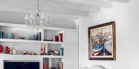 Living room, Furniture, Room, Interior design, Floor, Shelf, Property, Table, Wall, Wood flooring,