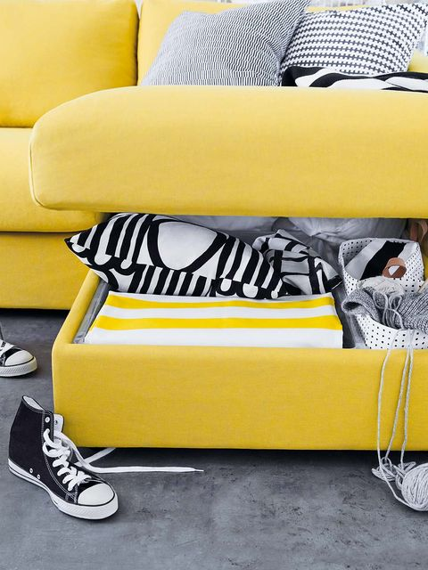 Yellow, Athletic shoe, Couch, Walking shoe, Living room, studio couch, Futon pad, Cushion, Slipcover, Skate shoe,