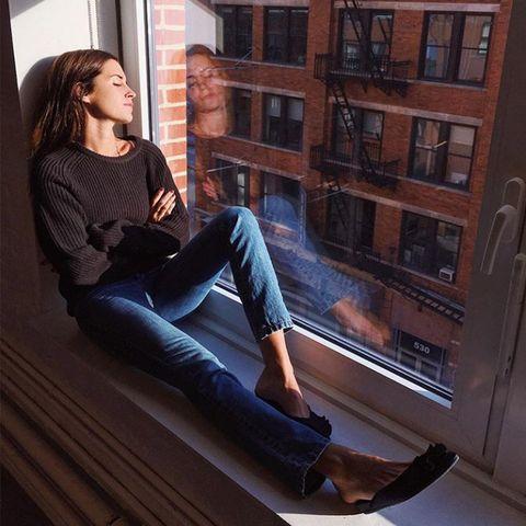 Jeans, Footwear, Leg, Beauty, Sitting, Joint, Brown hair, Shoe, Long hair, Denim,