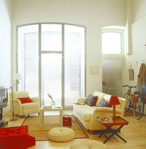 Room, Floor, Interior design, Flooring, Bicycle wheel, Bicycle wheel rim, Furniture, Couch, Living room, Wall,