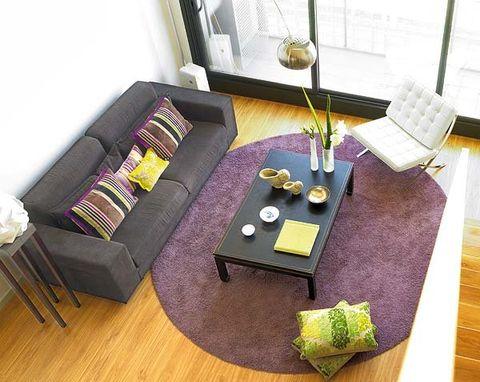 Wood, Room, Interior design, Flooring, Floor, Hardwood, Purple, Living room, Couch, Wood flooring,