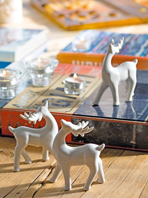 Fawn, Sculpture, Terrestrial animal, Toy, Tail, Reindeer, Porcelain, Wood flooring, Laminate flooring, Animal figure,