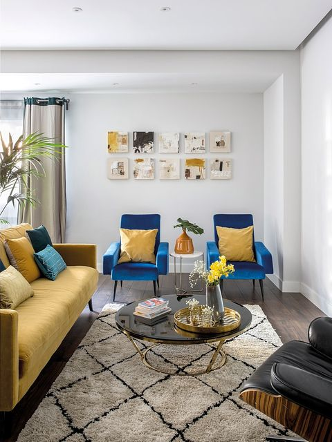 Living room, Room, Furniture, Blue, Interior design, Property, Yellow, Coffee table, Couch, Table,