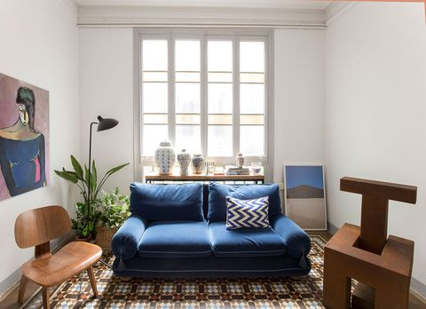 Living room, Furniture, Room, Couch, Interior design, Property, Blue, Floor, Coffee table, Home,
