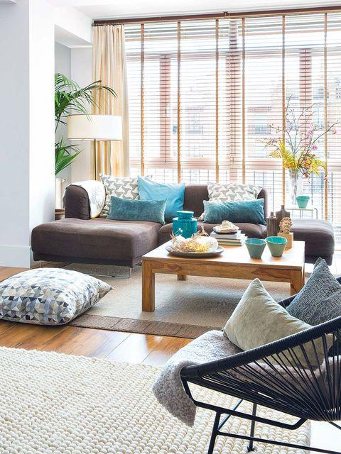 Blue, Interior design, Room, Floor, Furniture, Table, Living room, Flooring, Wall, Home,