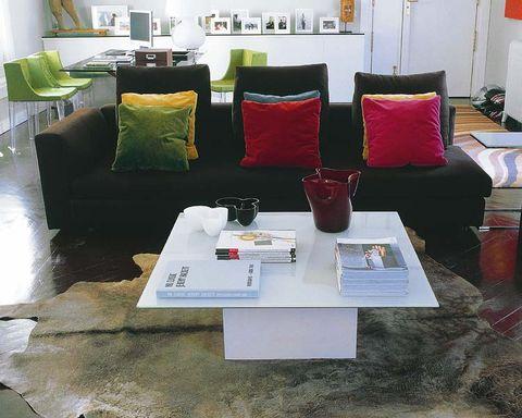 Room, Interior design, Green, Floor, Living room, Furniture, Table, Wall, Pillow, Interior design,