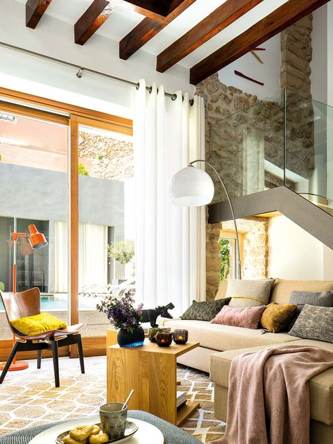 Interior design, Room, Yellow, Floor, Home, Living room, Furniture, Ceiling, Table, Wall,