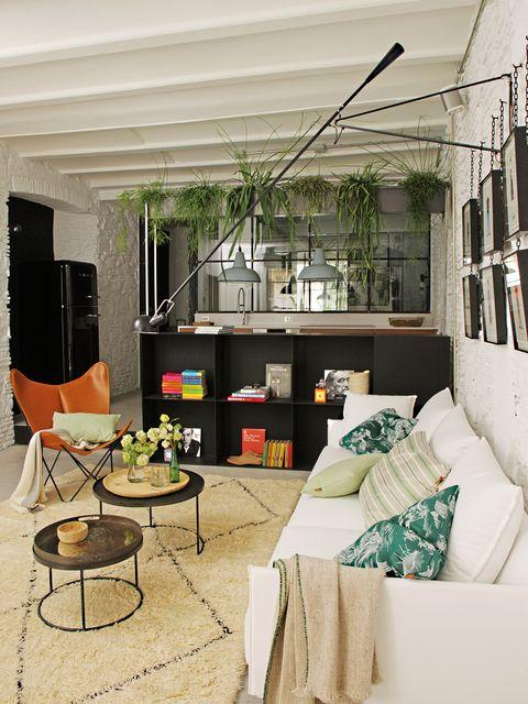 Precioso piso rehabilitado: Salón con ladrillo visto