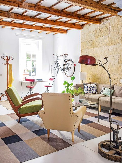 Bicycle wheel, Room, Interior design, Floor, Flooring, Wall, Bicycle frame, Ceiling, Bicycle fork, Furniture,