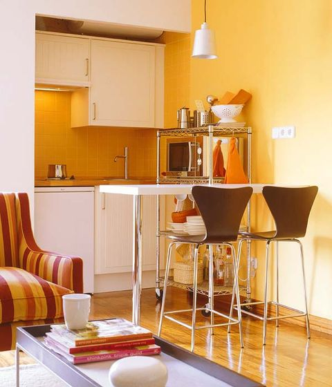 Room, Wood, Interior design, Yellow, Floor, Flooring, Serveware, Furniture, Cupboard, Orange,