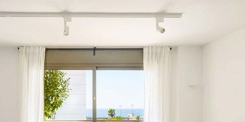 White, Room, Interior design, Furniture, Living room, Property, Coffee table, Ceiling, Curtain, House,