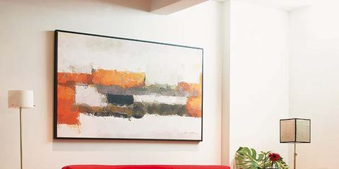 Room, Interior design, Wall, Furniture, Interior design, Picture frame, Orange, Paint, Coffee table, Flowerpot,