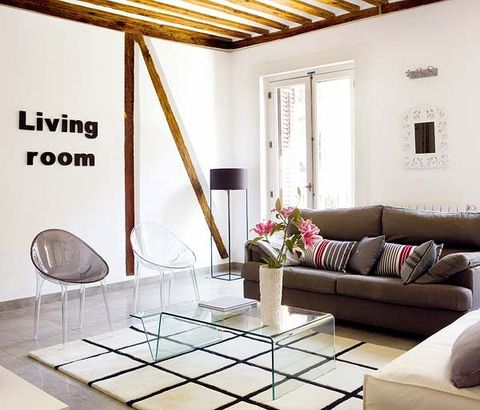 Interior design, Floor, Room, Living room, Wall, Couch, Ceiling, Flooring, Furniture, Table,