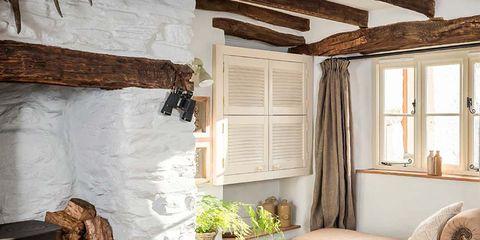 Wood, Room, Interior design, Living room, Floor, Home, Table, Furniture, Hearth, Wall,