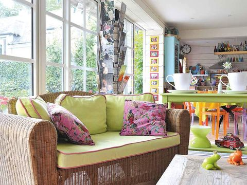 Room, Interior design, Green, Home, Furniture, Living room, Wall, Shelving, Couch, Purple,