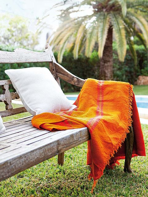 Furniture, Outdoor furniture, Arecales, Outdoor bench, Palm tree, Deciduous, Armrest, Linens, Tropics, Outdoor table,