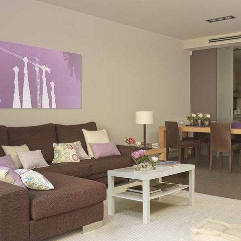 Room, Interior design, Floor, Flooring, Furniture, Table, Living room, Wall, Purple, Couch,