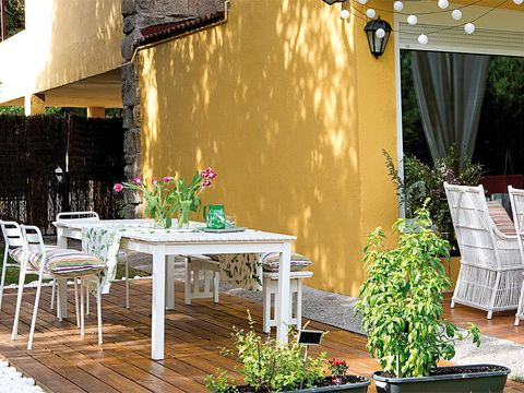 Property, Furniture, Table, Patio, Yellow, Room, Interior design, Wall, Building, Restaurant,
