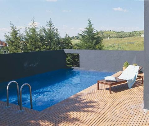 Swimming pool, Outdoor furniture, Sunlounger, Azure, Composite material, Shade, Armrest, Resort, Chaise longue, Tile,