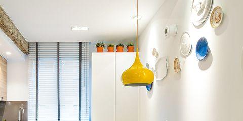 Room, Yellow, Interior design, Floor, Table, Flooring, Ceiling, Furniture, Dining room, Light fixture,