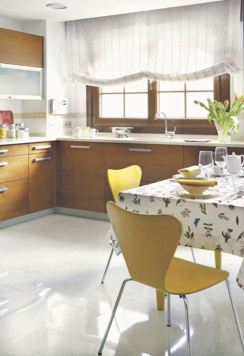 Room, Floor, Yellow, Interior design, Flooring, Furniture, Tablecloth, Cupboard, Cabinetry, Table,