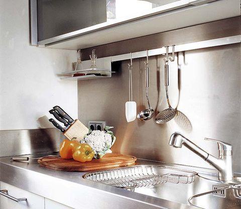 Room, Countertop, Kitchen, Kitchen appliance, Kitchen stove, Grey, Cookware and bakeware, Kitchen utensil, Kitchen appliance accessory, Tap,