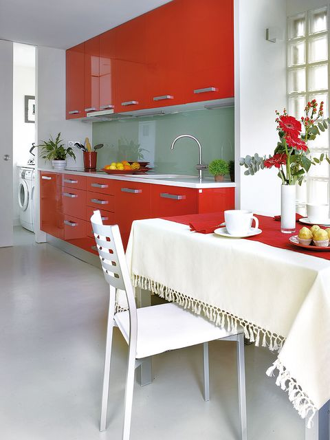 Room, Tablecloth, Interior design, Floor, Red, White, Cupboard, Home, Cabinetry, Flooring,