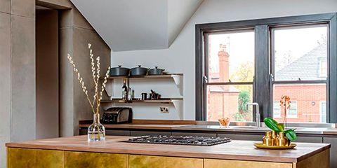 Countertop, Furniture, Kitchen, Cabinetry, Room, Floor, Property, Interior design, Yellow, Flooring,