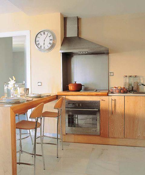 Incorpora a la cocina un comedor de diario for Cocina con comedor diario