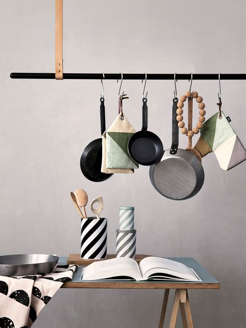 Pot rack, Linens, Home accessories, Tablecloth, Grey, Still life photography, Dishware, Interior design, Teal, Earrings,