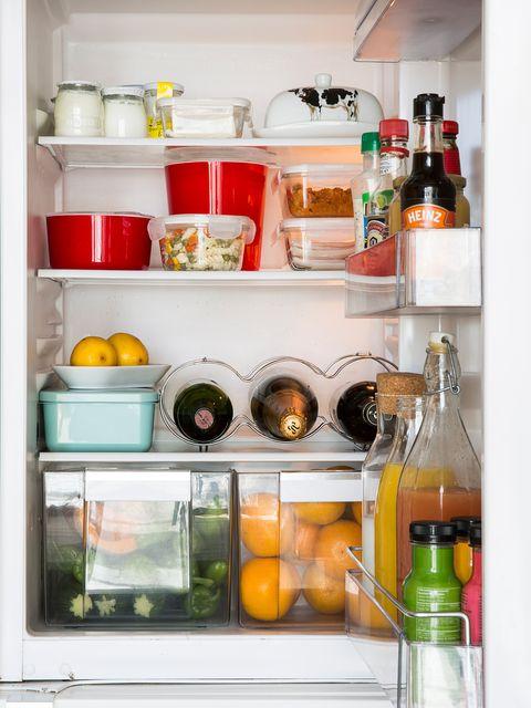 Liquid, Bottle, Food, Major appliance, Glass bottle, Kitchen appliance, Drink, Freezer, Refrigerator, Home appliance,