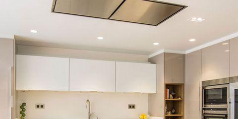 Room, Property, Interior design, Ceiling, Floor, Furniture, Cupboard, Orange, Light fixture, Kitchen appliance,