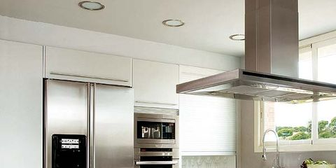 Countertop, Room, Kitchen, Floor, Cabinetry, Furniture, Property, Interior design, Major appliance, Refrigerator,