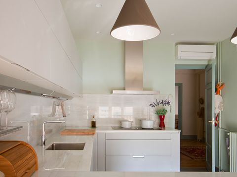 Room, Interior design, Green, Property, Floor, White, Ceiling, Wall, Light fixture, Drawer,